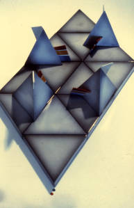 Prisms. Slip cast white earthenware with airbrushed and transfer printed onglaze enamel. 1976.